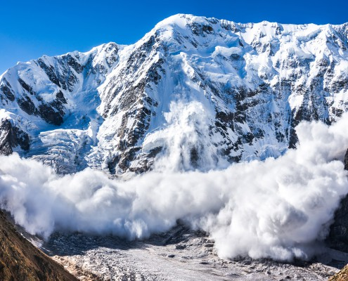 Power of nature. Real huge avalanche comes from a big mountain (Shkhara, 5,193 m), Caucasus, Kabardino-Balkaria, Bezengi region, Russia